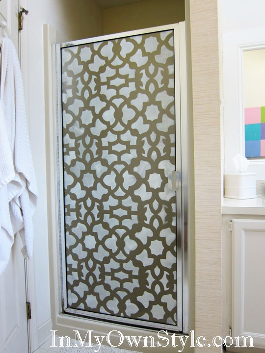 a simple shower door made bolder with pretty stencils looks outstanding and eye catching
