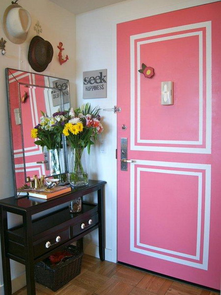 a pink door with white stenciling that makes it bolder, cooler and catchier and adds a refined touch