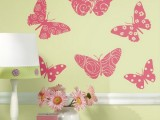 yellow wallpaper with pink printed butterflies is a cool and bright idea to rock in the space