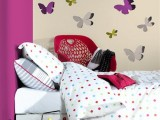colorful butterfly decals on the wall will make the nook stand out a lot and will make it cute