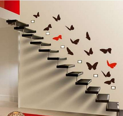 black and red butterfly decals over the airy staircase make it look very more lightweight and cool