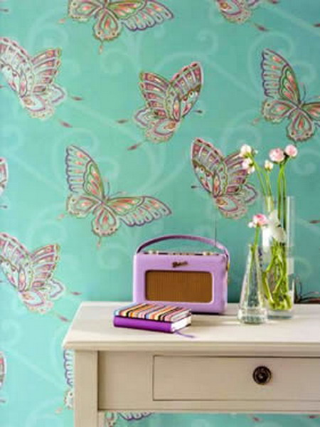 green wallpaper with colorful butterfly print is a cool idea to make a statement in your home