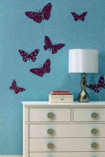 blue wallpaper with deep purple butterfly decals that can be removed in case you get tired of them