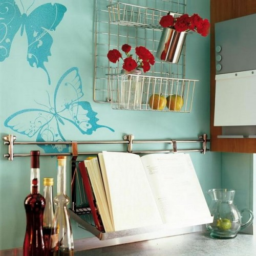 blue wallpaper with bolder blue butterfly printing for a cute and sweet touch in the space