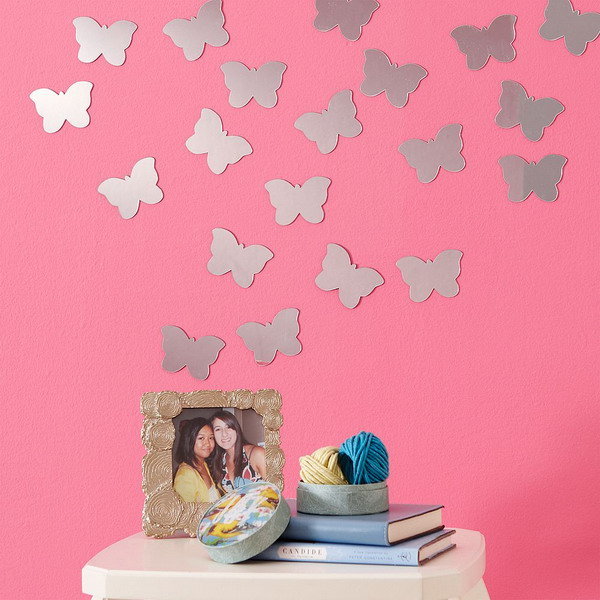 silver butterfly decals will stand on pink wallpaper and add a sweet girlish feel to the space