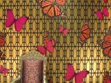 refined gold printed wallpaper and pink and red butterfly decals that make a cool and bright accent on the walls