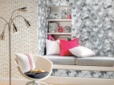 monochromatic grey butterfly wallpaper makes this cozy little nook stand out a lot in the neutral space