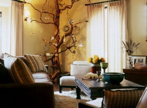 a whole tree trunk in the corner of the room decorated with photos and dreamcatchers will add a boho feel to the space