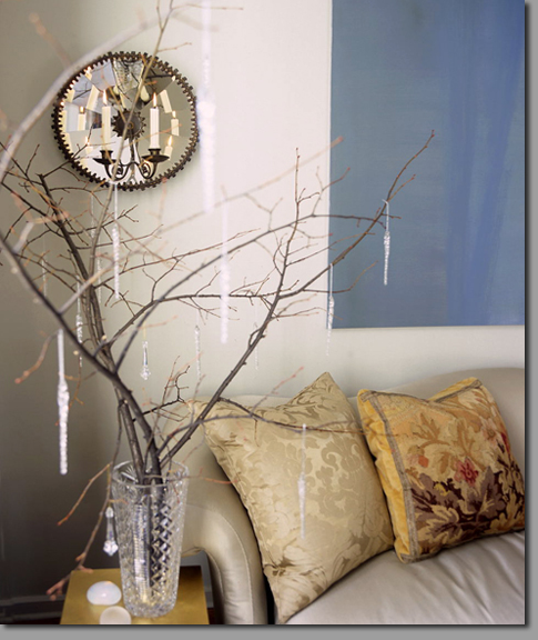 a crystal vase with branches and hanging crystals on them is a cool idea - making such an arrangement is easy and takes no time