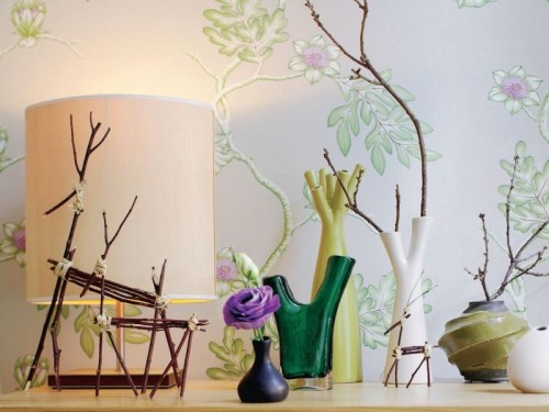 a whole arrangement of vases with branches and some branch combos on the shelf for a cool natural feel