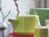 a kettle with a stick handle and some stick handle spoons is a cool idea for adding a natural touch to your table
