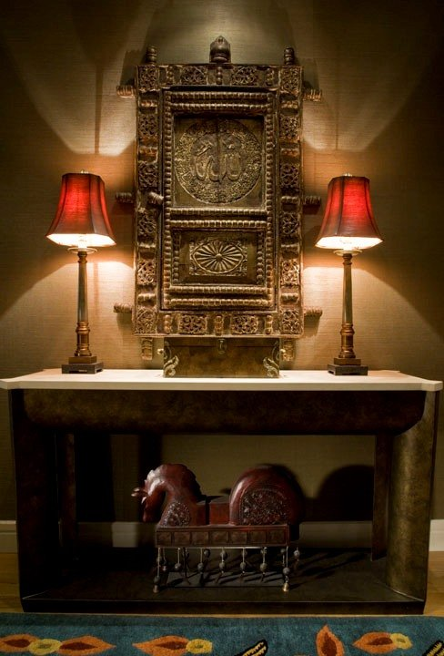 Table lamps work really well on console table to provide additional dramatic light to the room.