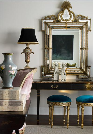 A mirror above a console table works extremely well to visually enlarge the space
