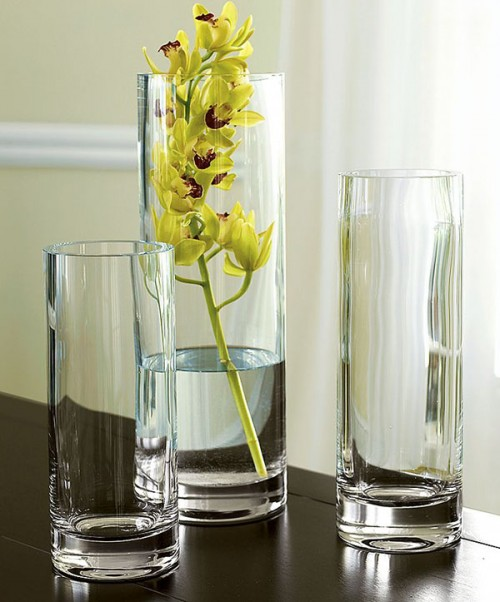 tall glass vases and a vase with a yellow orchid is a refined fall decoration or a refined centerpiece