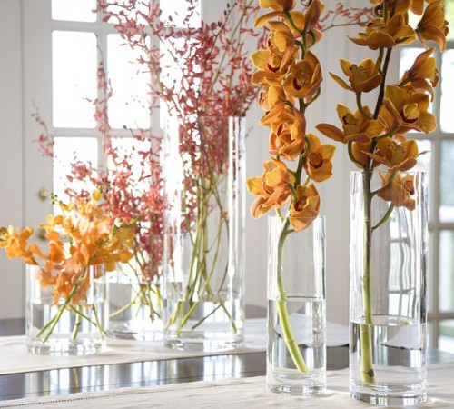 tall vases with bold fall blooms is a cool centerpiece or arrangement for autumn