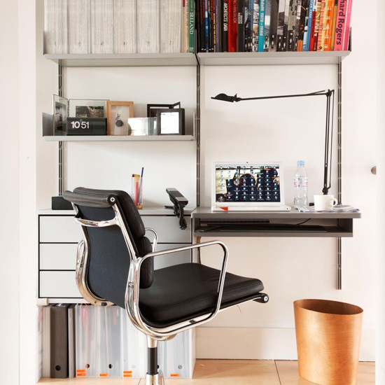 cool storage idea for a home office desk and shelving system in one