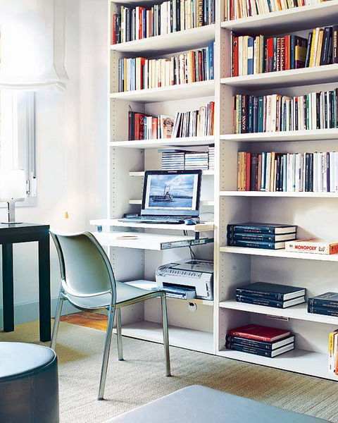 Sliding shelf is a perfect way to create a work station right in a bookcase.