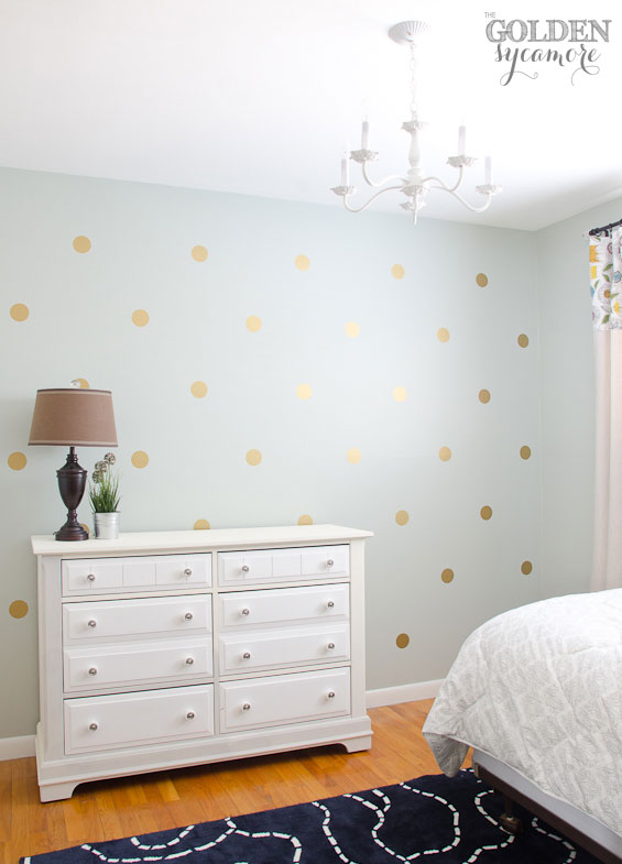 gold polka dot accent wall