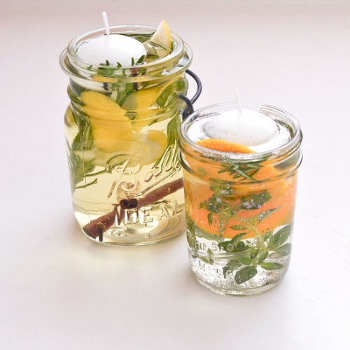 scented floating citronella candles (via savvysugar)