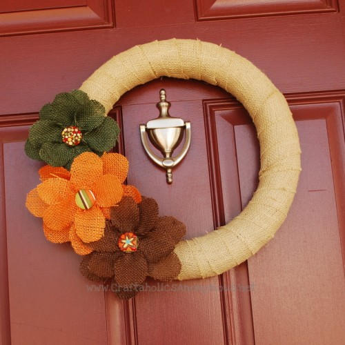 burlap and fabric flowers wreath (via shelterness)