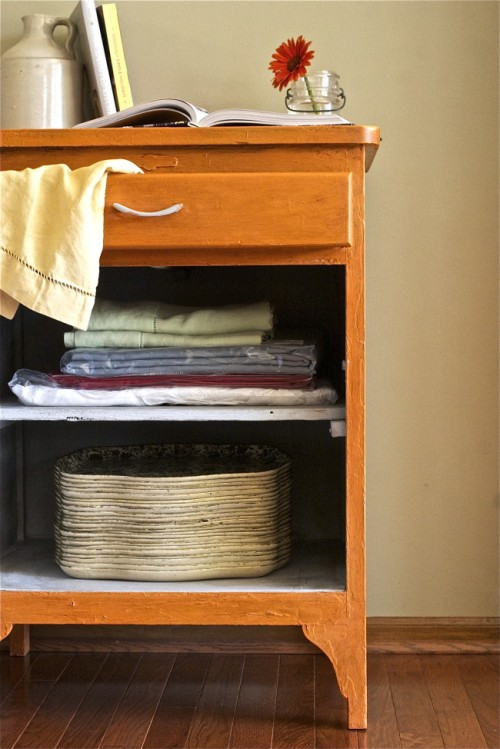 painted and waxed cabinet makeover (via offbeatandinspired)