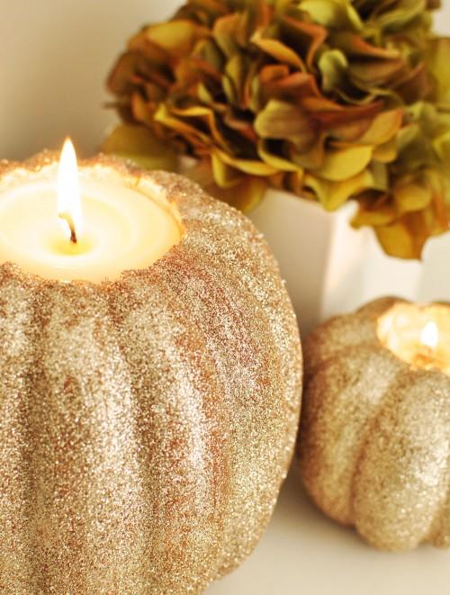 glitter pumpkin candleholders (via shelterness)
