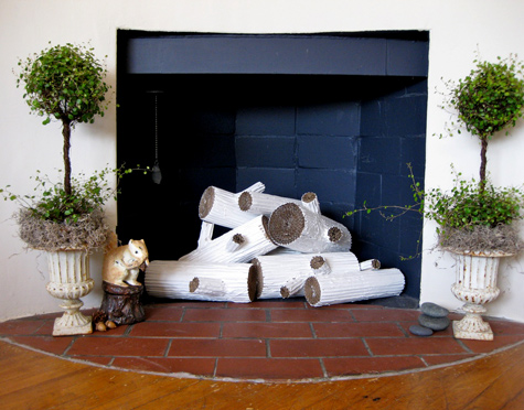 DIY Cardboard Faux Logs To Decorate Your Fireplace