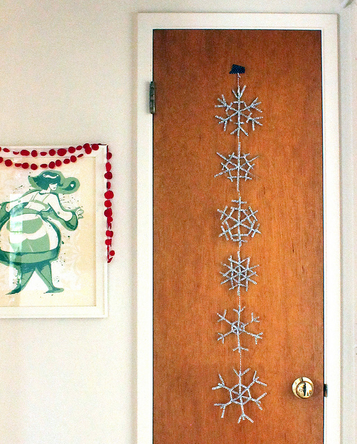 Picture of silver snowflake garland for Diy christmas front door decorations