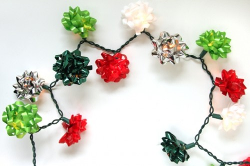 Christmas bow string lights (via shelterness)