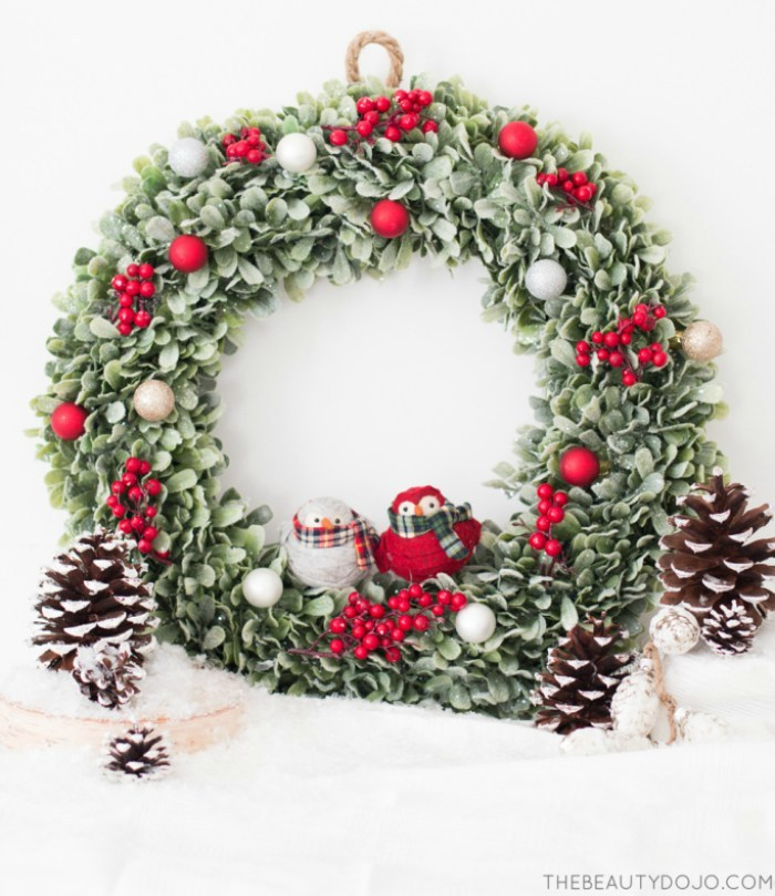 Picture Of diy christmas wreath with holly and small ornaments  1