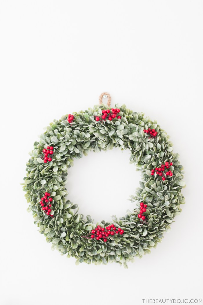 Picture Of diy christmas wreath with holly and small ornaments  2
