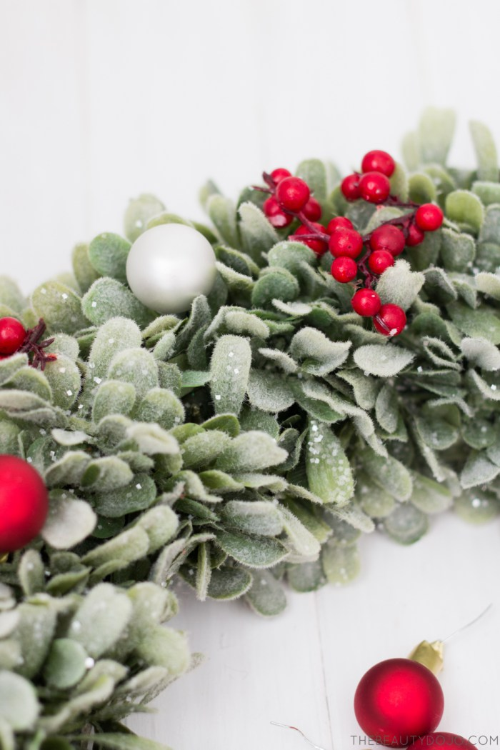 Picture Of diy christmas wreath with holly and small ornaments  4