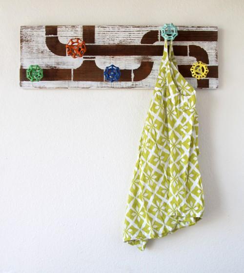 reclaimed wood and faucet coat rack (via apieceofrainbow)