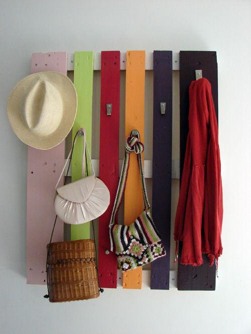 colorful coat rack of a pallet (via shelterness)