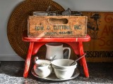 red bench and crate coffee station