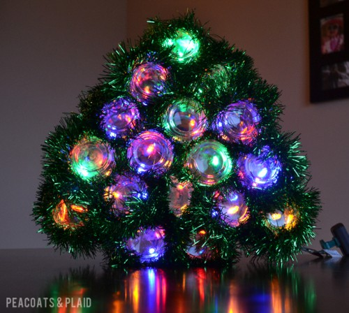 mason jar and lights Christmas tree (via soyouthinkyourecrafty)