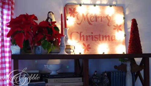 Christmas sign with lights (via createandbabble)