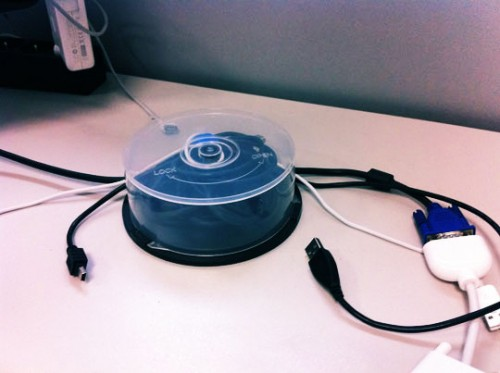 Diy desk cable organizer of a cd spool container shelterness - Desk cord organizer ...