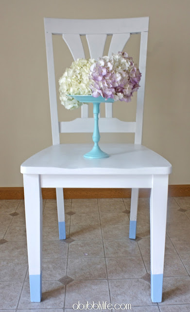 white chairs with aqua legs (via abubblylife)