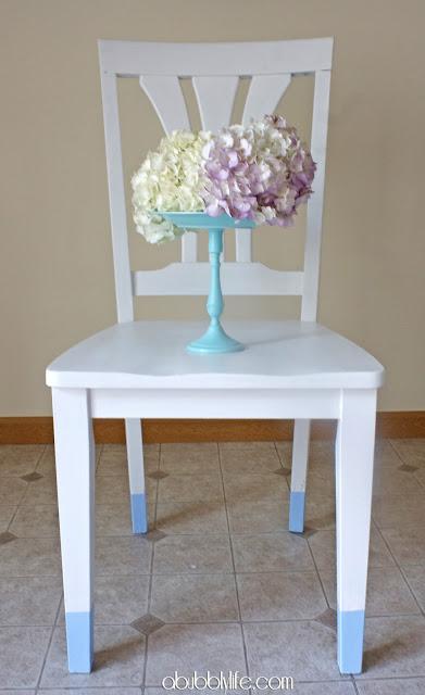 white chairs with aqua legs (via abubblylife)