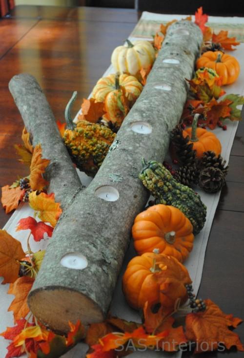 pumpkins and candles centerpiece (via shelterness)