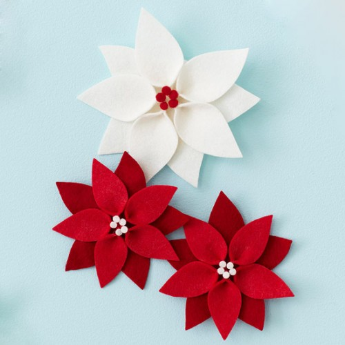 Red and white poinsettias will pop against any evergreen swag or tree.