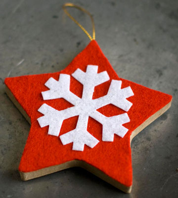 A white snowflake pops against a bright red star.