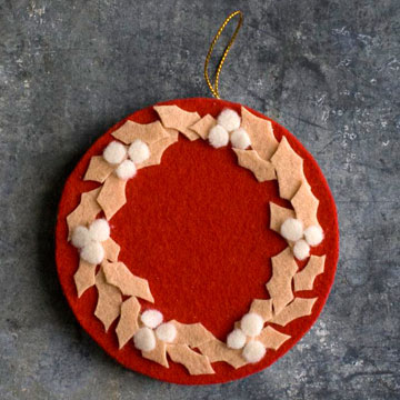 Christmas wreaths aren't only for front doors. These mini wreath ornaments with thin wooden disks used for their bases are quick and easy to make.