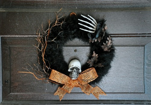 Halloween wreath with a skull and a hand (via shelterness)