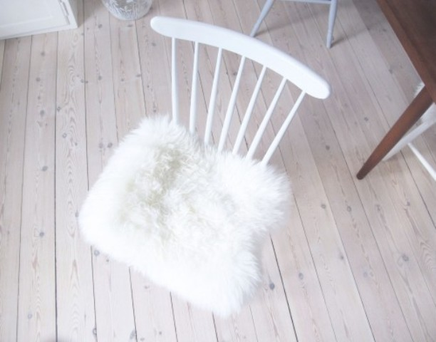 Picture Of diy ikea sheep skin hack into chair covers  2