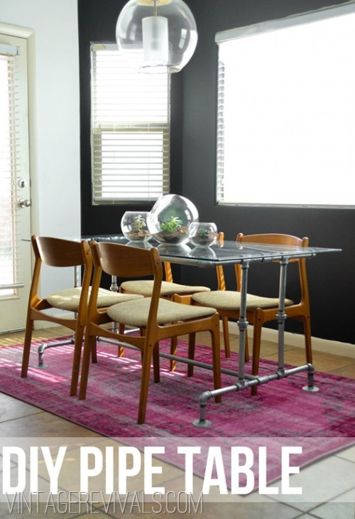 industrial dining table with a glass top (via vintagerevivals)
