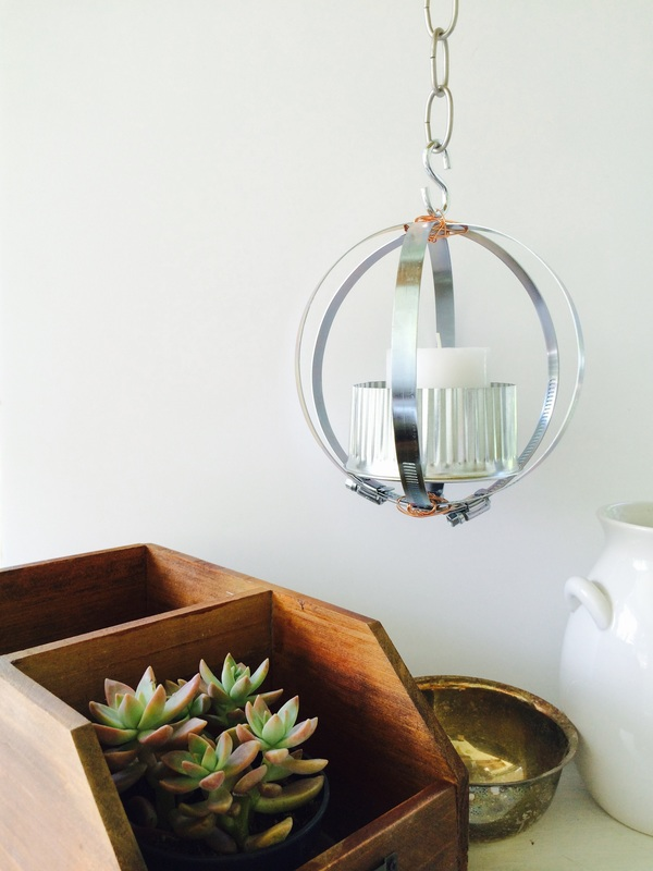 Picture Of diy industrial lantern from metal clamps  2