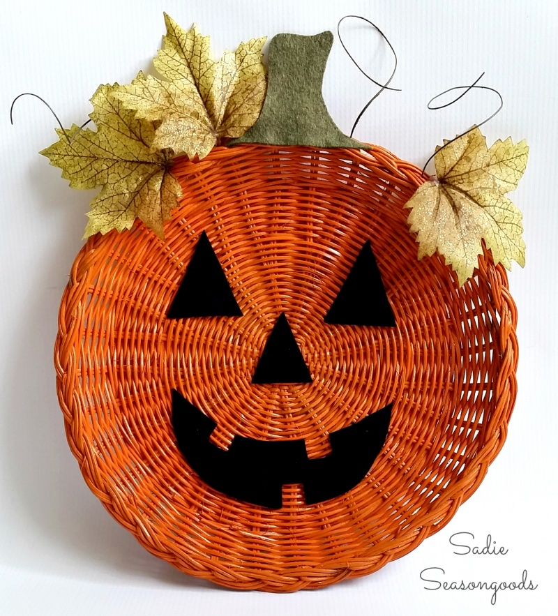 Picture Of diy jack o lantern decor from a plate holder  1