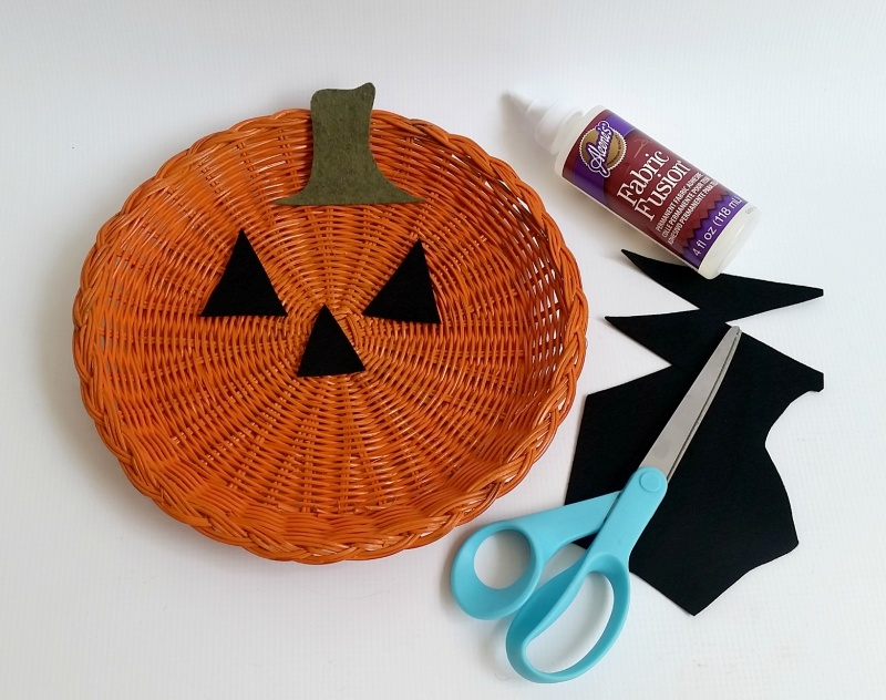 Picture Of diy jack o lantern decor from a plate holder  3
